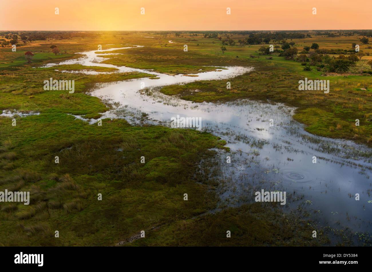 Sunset on Okavango Delta, Chobe National Park, Botswana, Africa - Stock Image