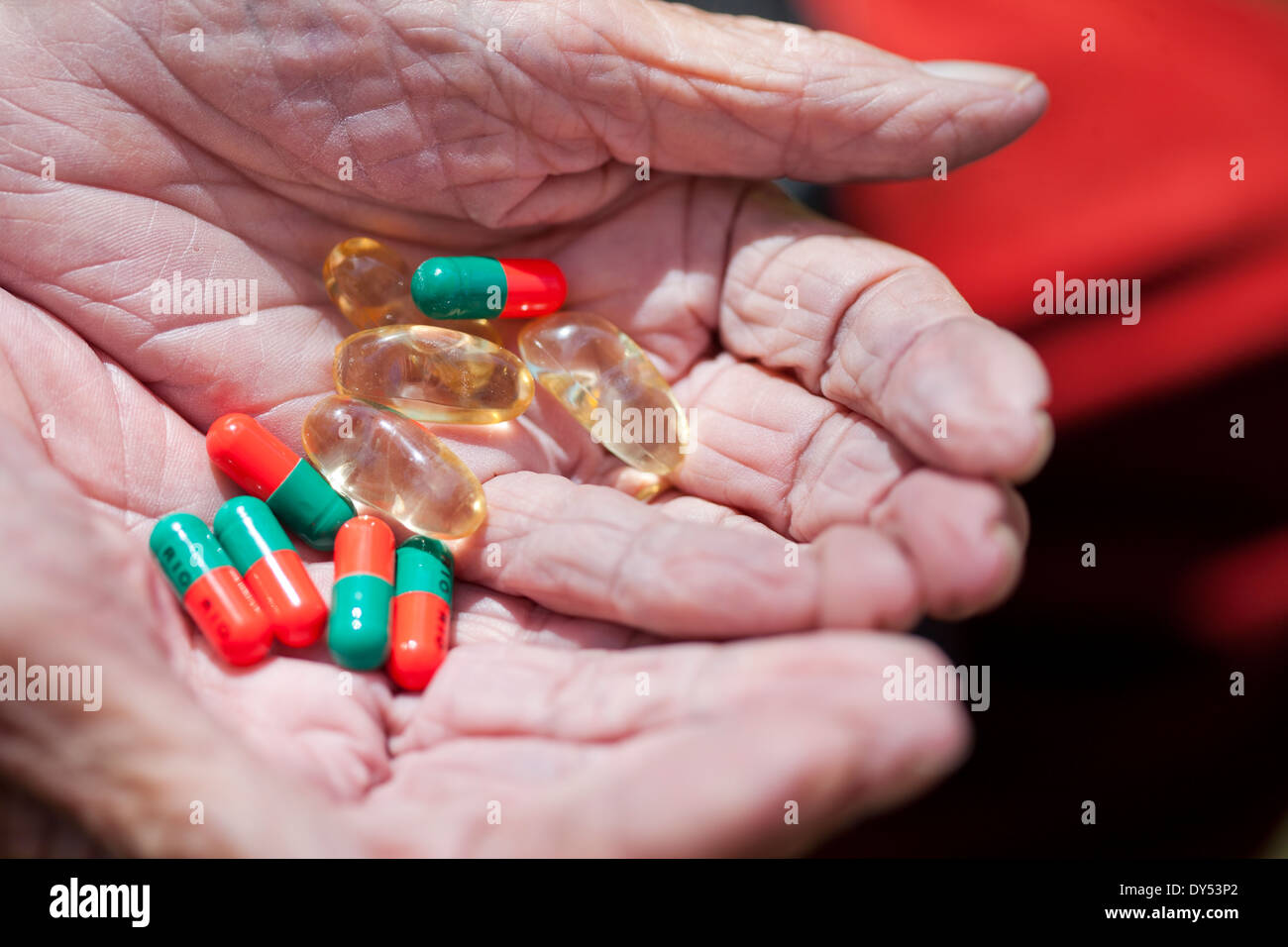 Close up of senior woman's hands holding pills Stock Photo