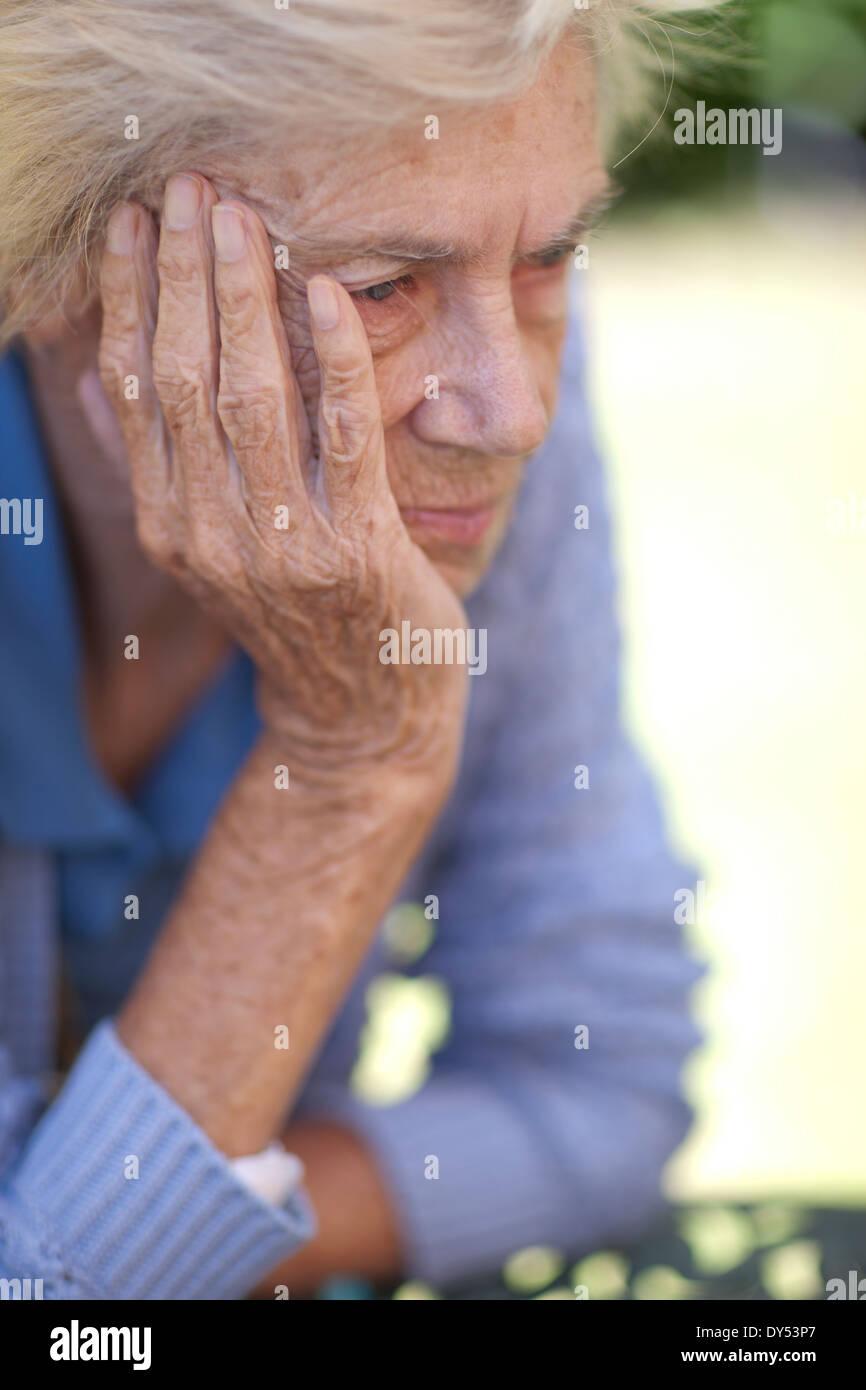 Close up of unhappy senior woman - Stock Image