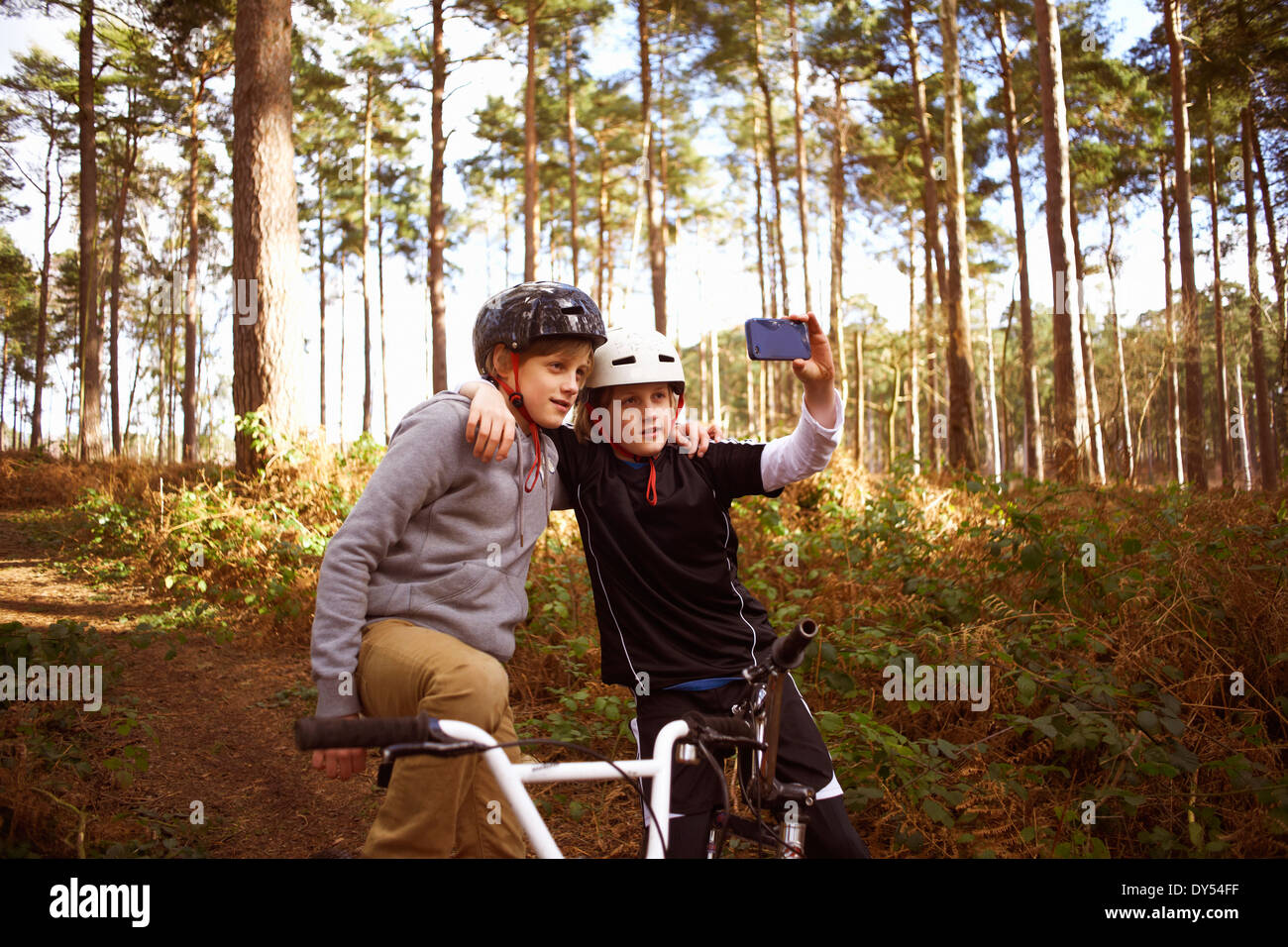 Twin brothers on BMX bikes taking self portrait Stock Photo