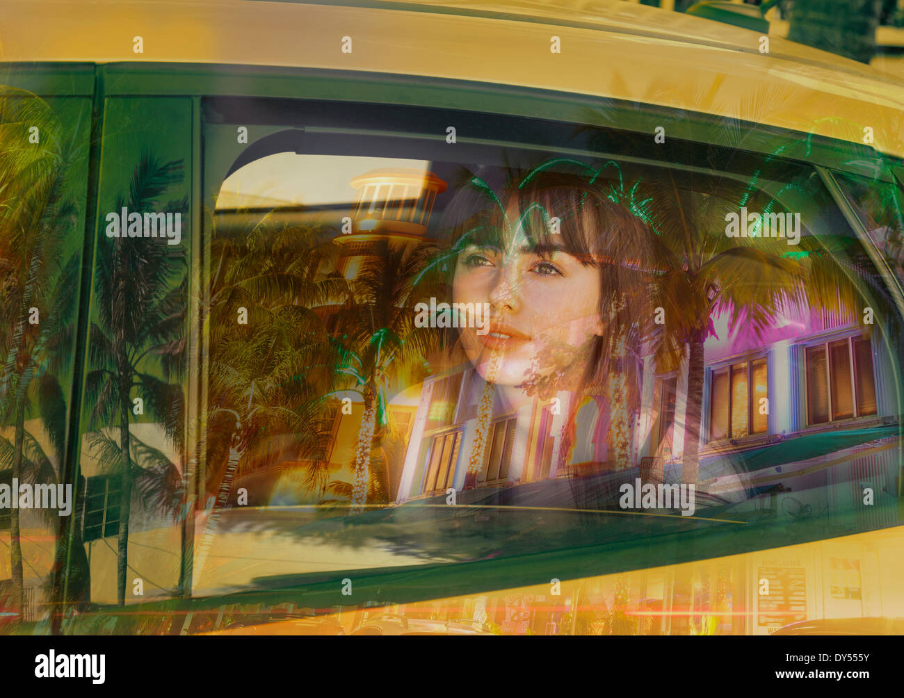 Young woman in back of taxi - Stock Image