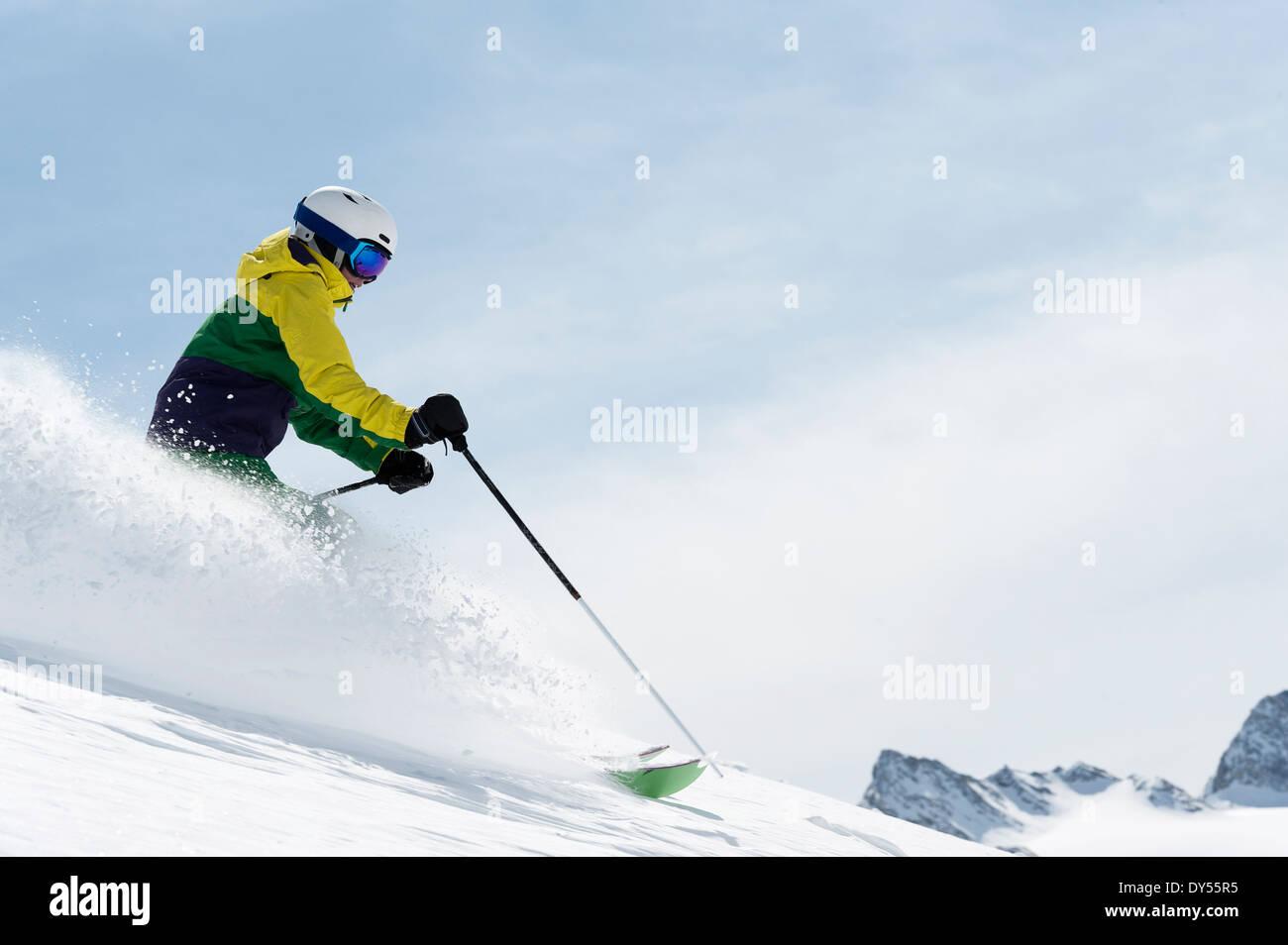 Young woman skiing downhill, Obergurgl, Austria - Stock Image