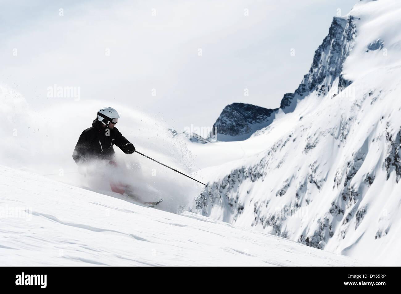 Mid adult man skiing downhill, Obergurgl, Austria - Stock Image