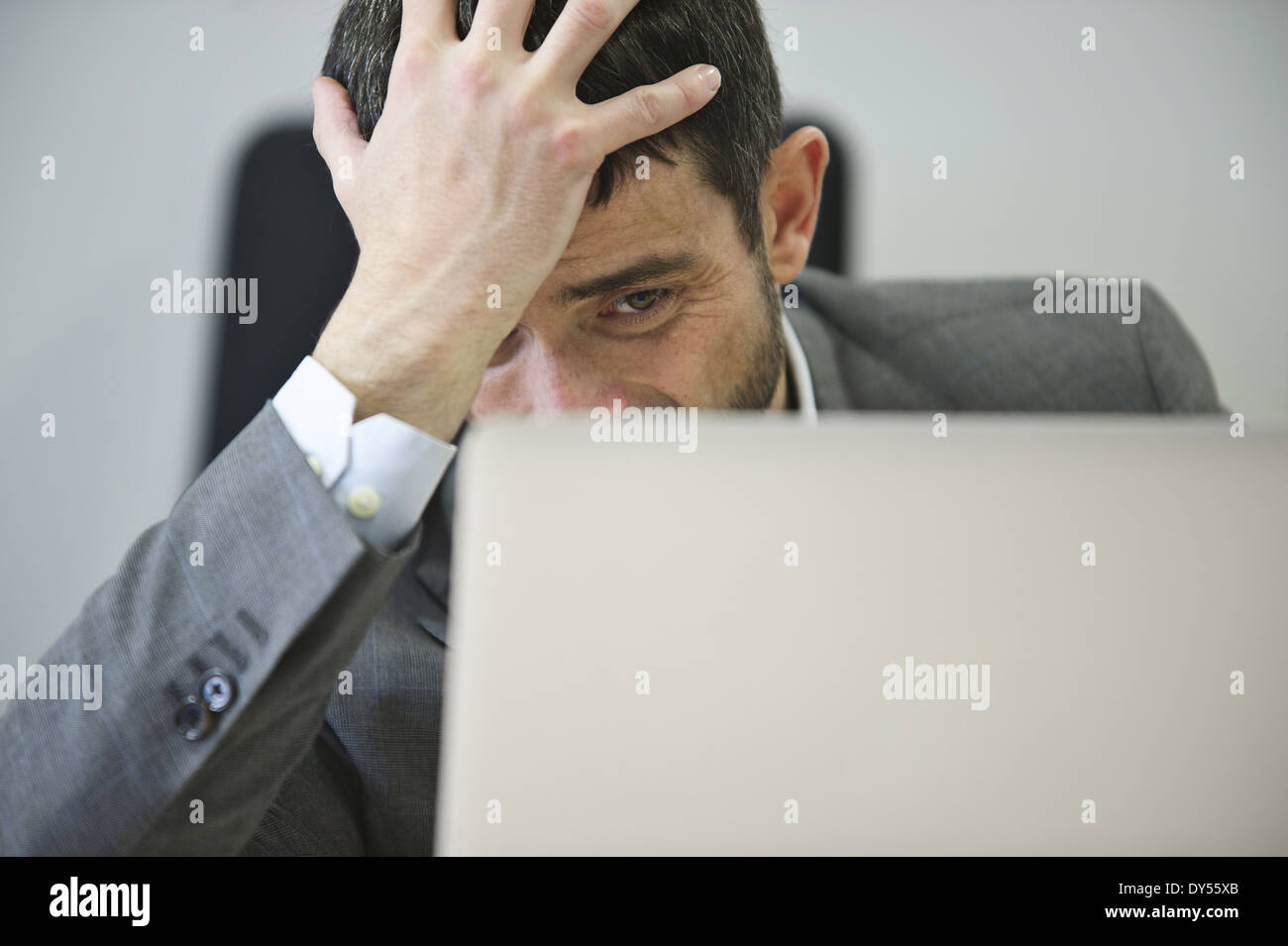 Young businessman looking stressed - Stock Image
