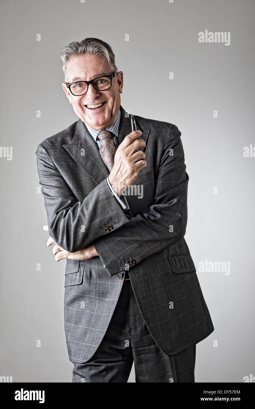 Portrait of senior man, wearing suit - Stock Image