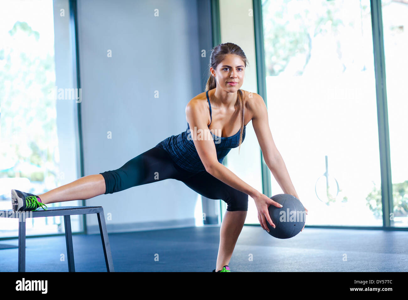 Young woman working out with medicine ball - Stock Image