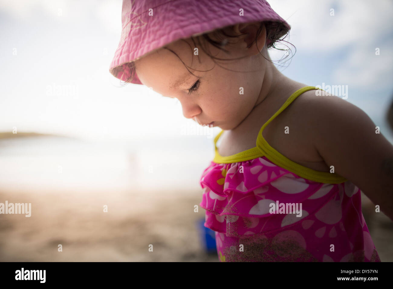 Baby playing on sandy beach - Stock Image