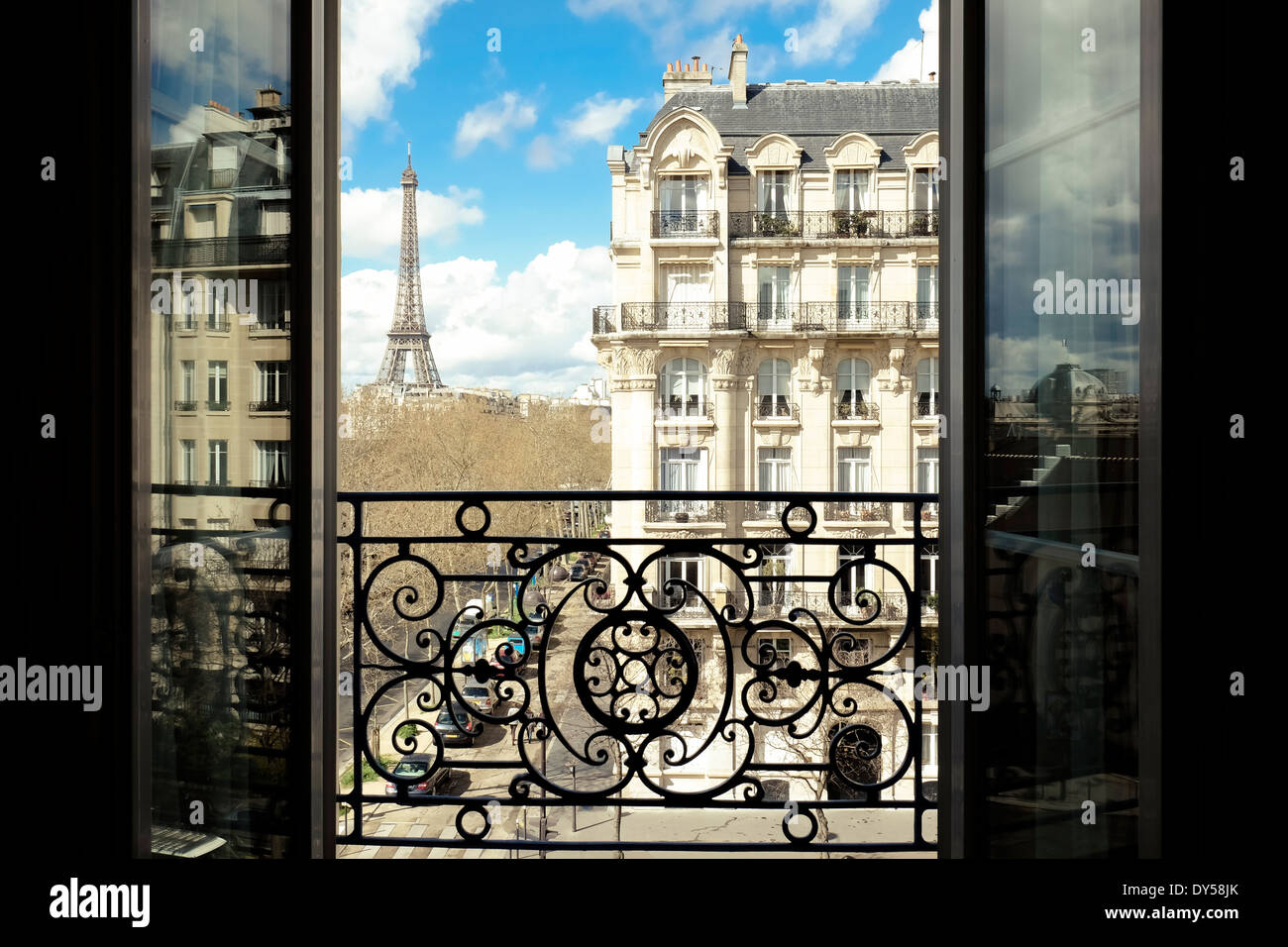 The Eiffel Tower, Paris, France, viewed through an open window. - Stock Image