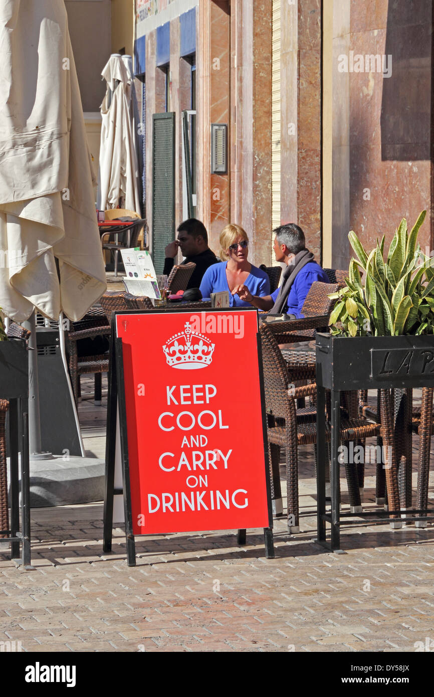 Keep Cool and Carry on Drinking sign outside bar, Malaga, Spain - Stock Image