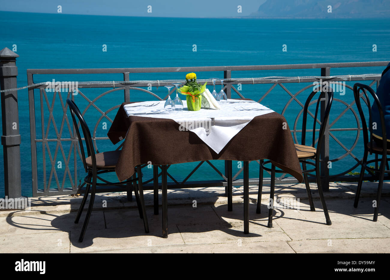 table in a restaurant on the sea - Stock Image
