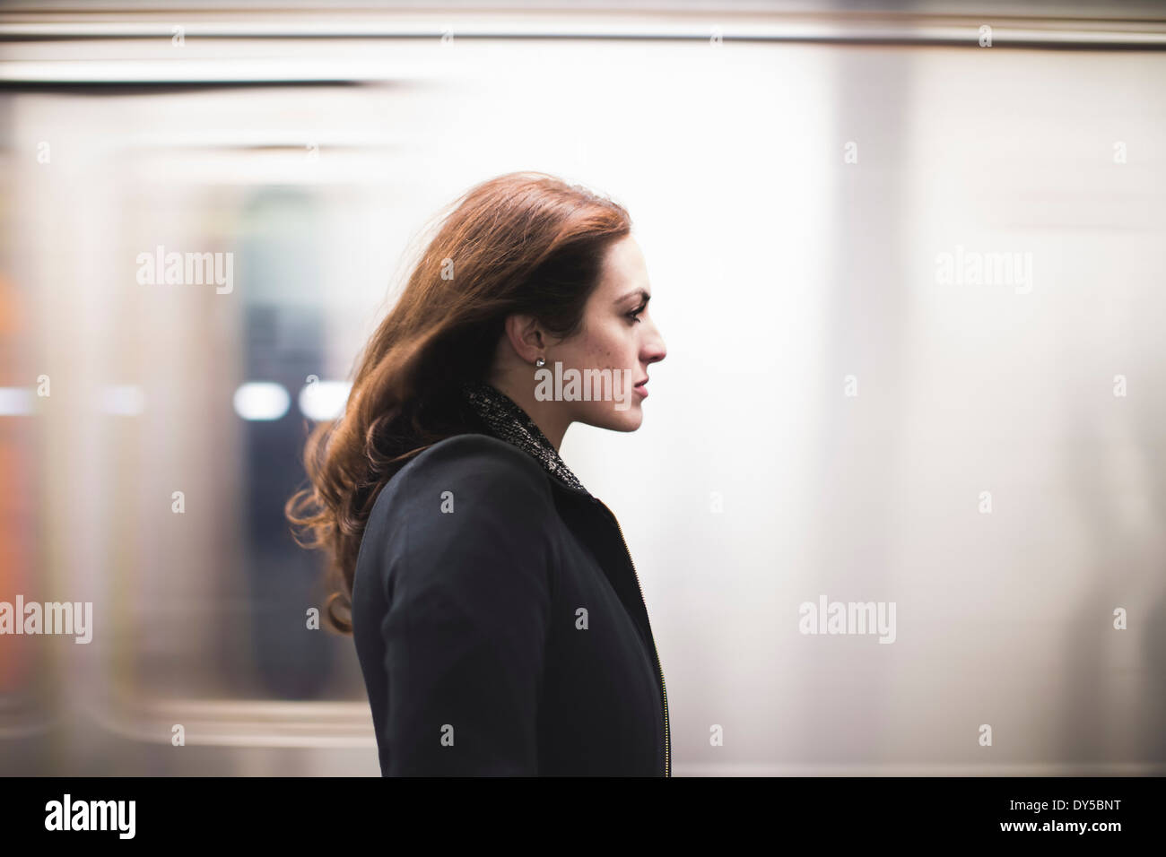 Young woman commuting on subway - Stock Image