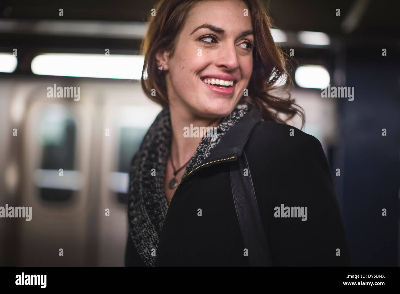 Young woman in subway station - Stock Image