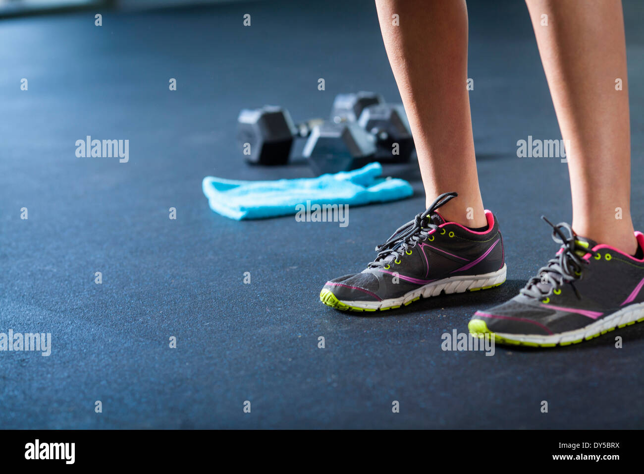 Sports shoes, weights, towel - Stock Image