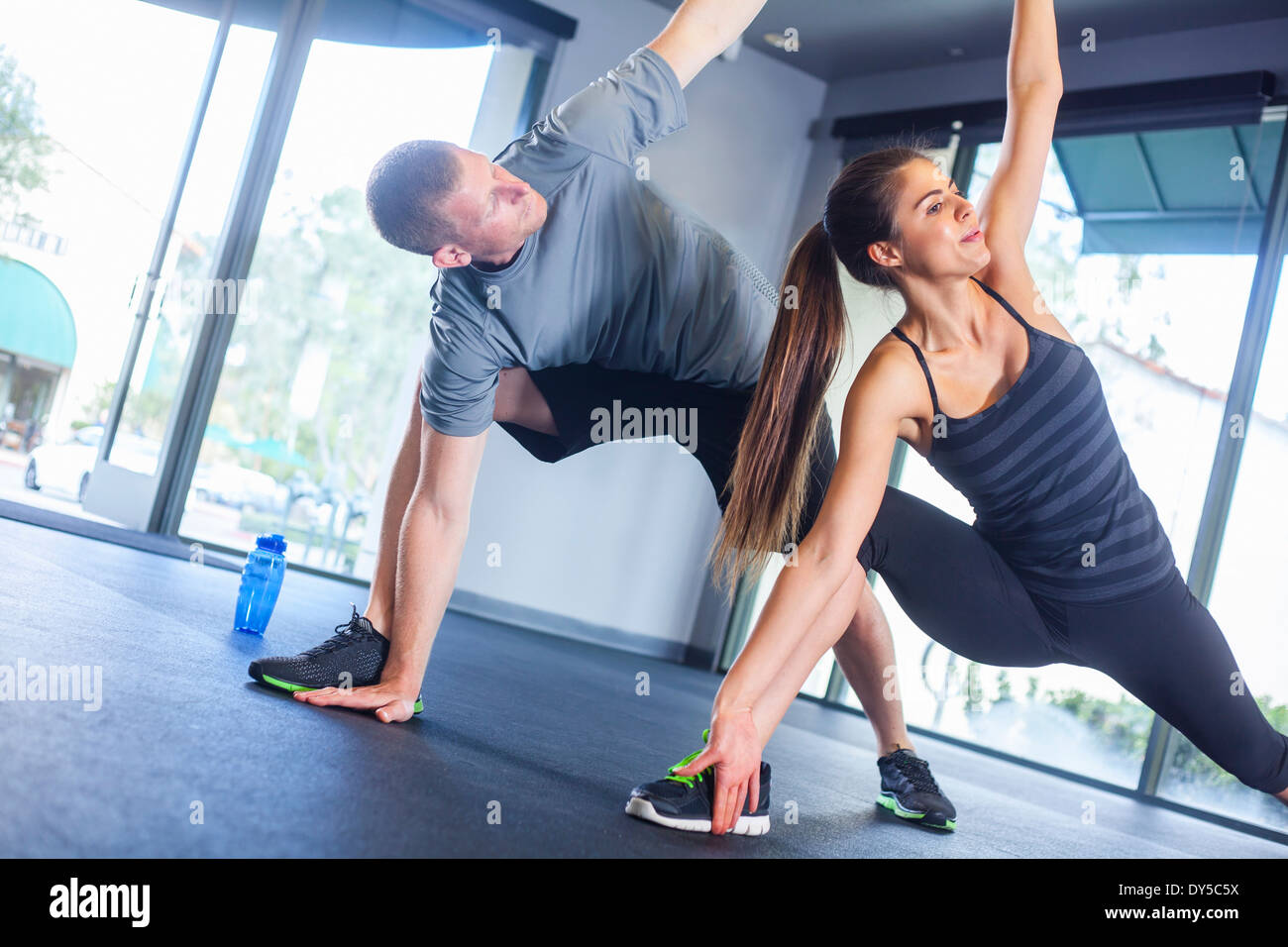 Couple in triangle pose - Stock Image