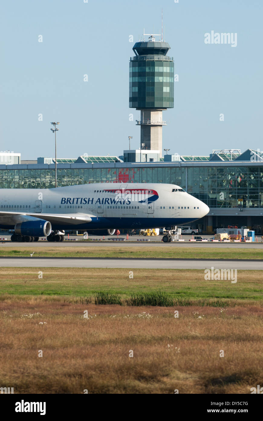 British Airways commercial jet taxiing at Vancouver International Airport. - Stock Image