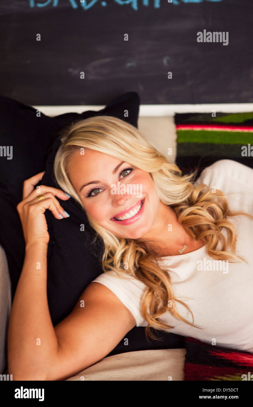 Young woman with blonde hair, smiling - Stock Image