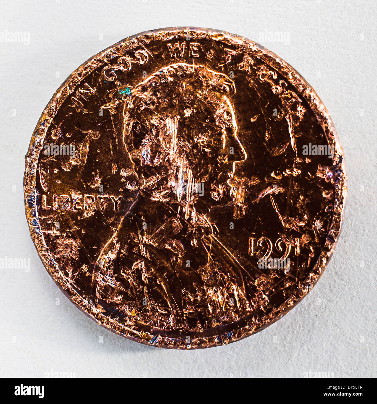 Still life of a scratched one cent coin - Stock Image
