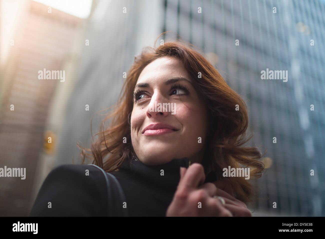 Young woman on street, New York, USA - Stock Image