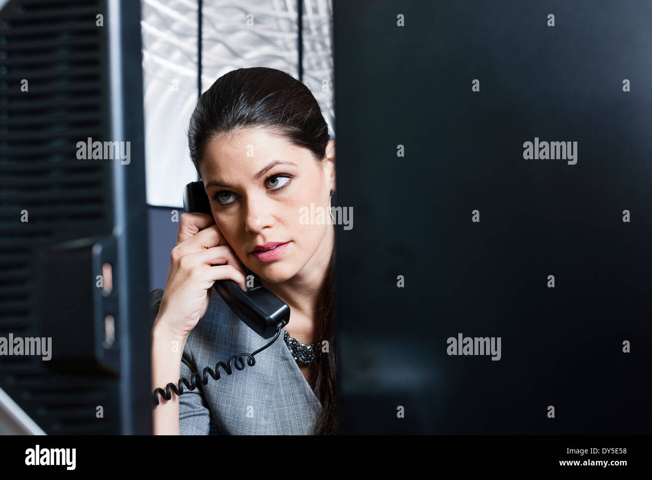 Young businesswoman on telephone call - Stock Image