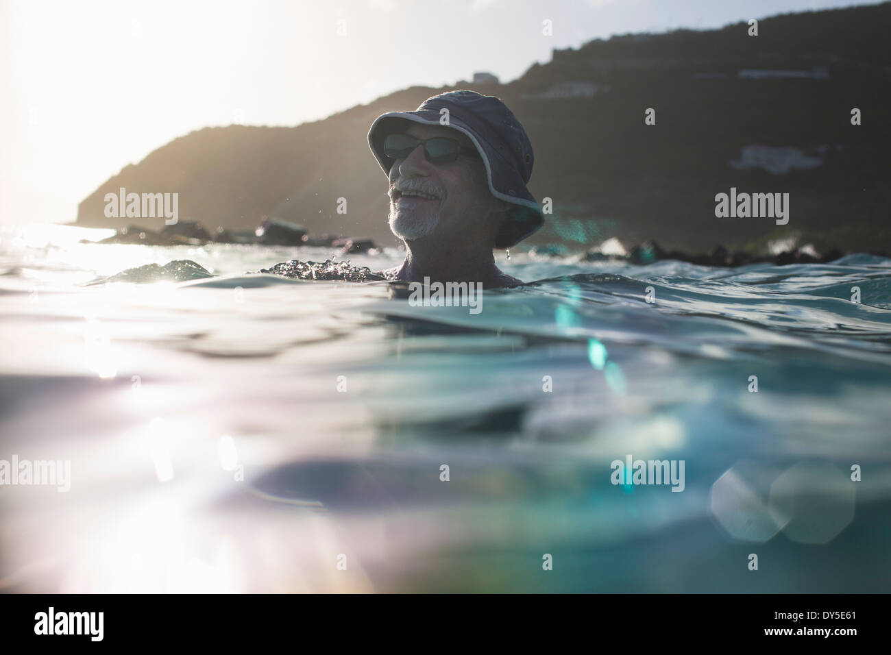 Senior man swimming in the sea - Stock Image