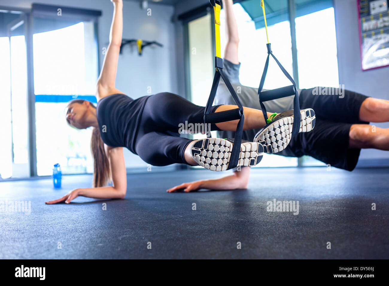 Couple doing side plank exercise - Stock Image