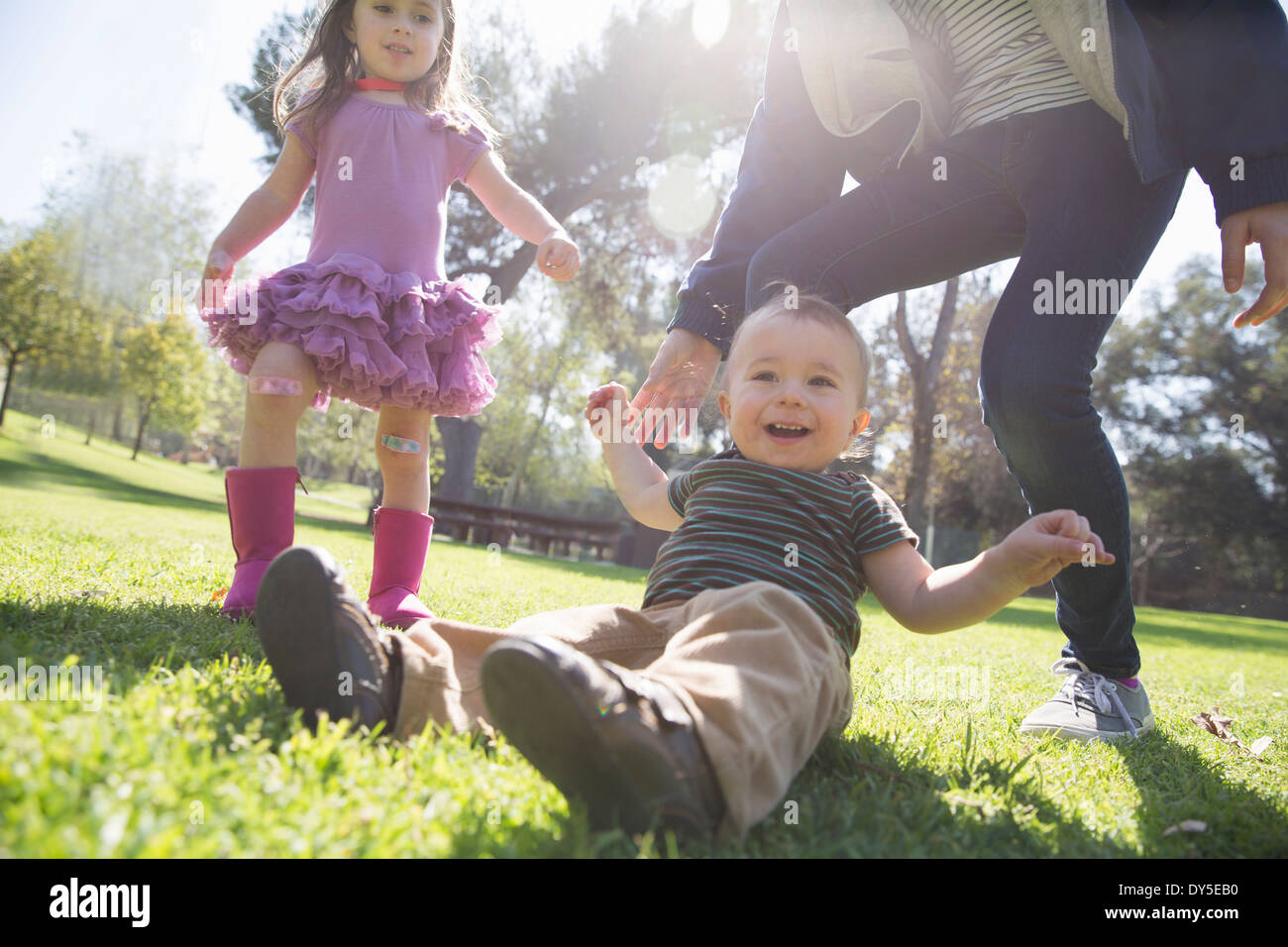 Siblings playing in park - Stock Image