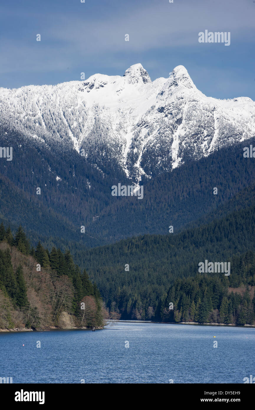 Capilano watershed, with the snow capped Lions as a backdrop. - Stock Image