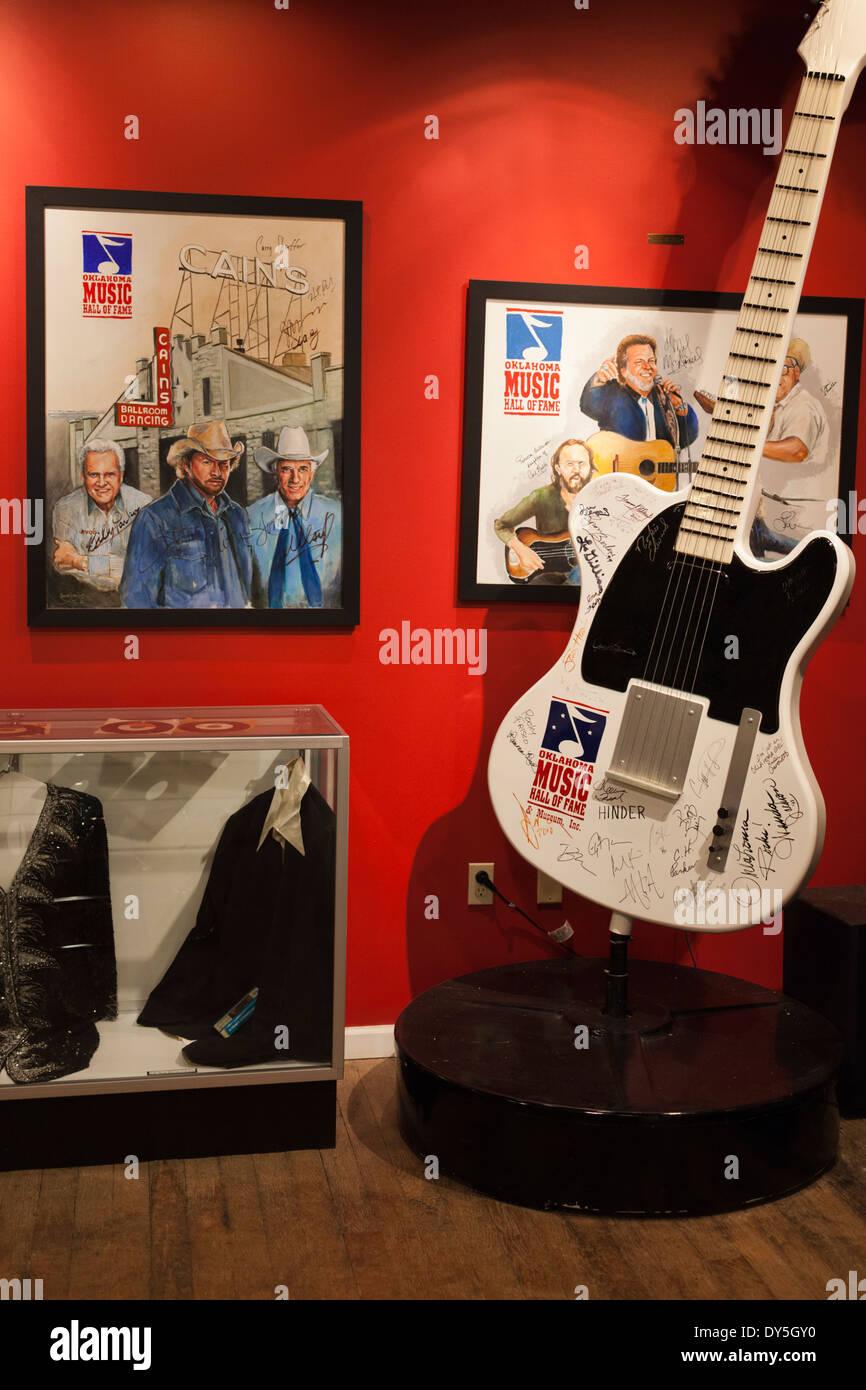 USA, Oklahoma, Muskogee, Oklahoma Music Hall of Fame interior display and guitar Stock Photo