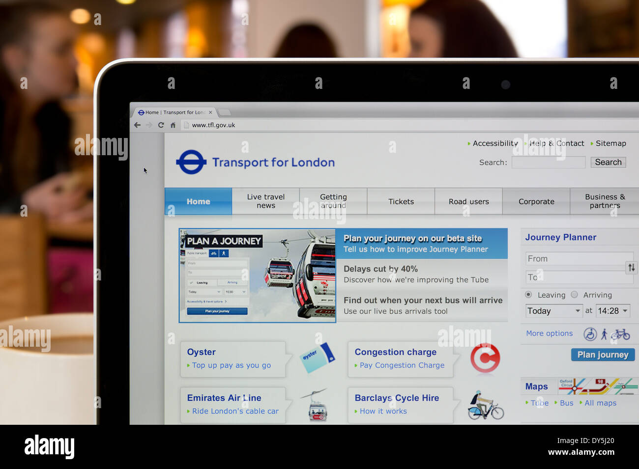 The TfL website shot in a coffee shop environment (Editorial use only: print, TV, e-book and editorial website). - Stock Image