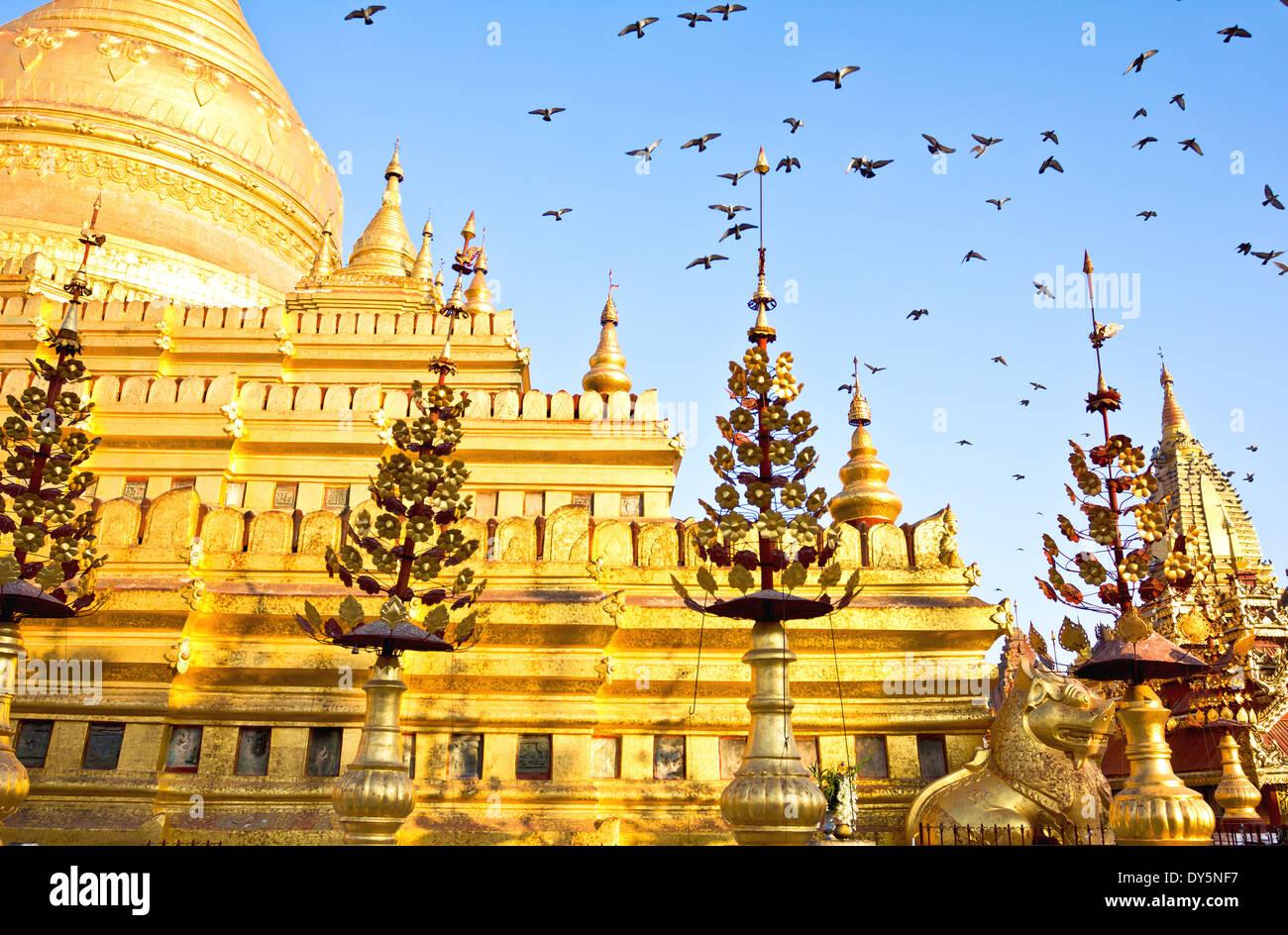Shwezigon Pagoda or Shwezigon Paya at early morning in Bagan, Burma Stock Photo