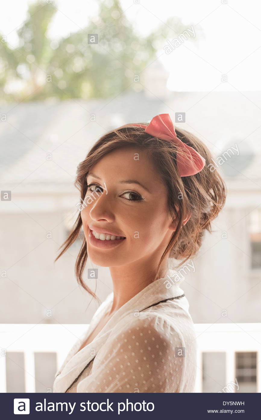 Portrait of feminine young woman in sunlight - Stock Image