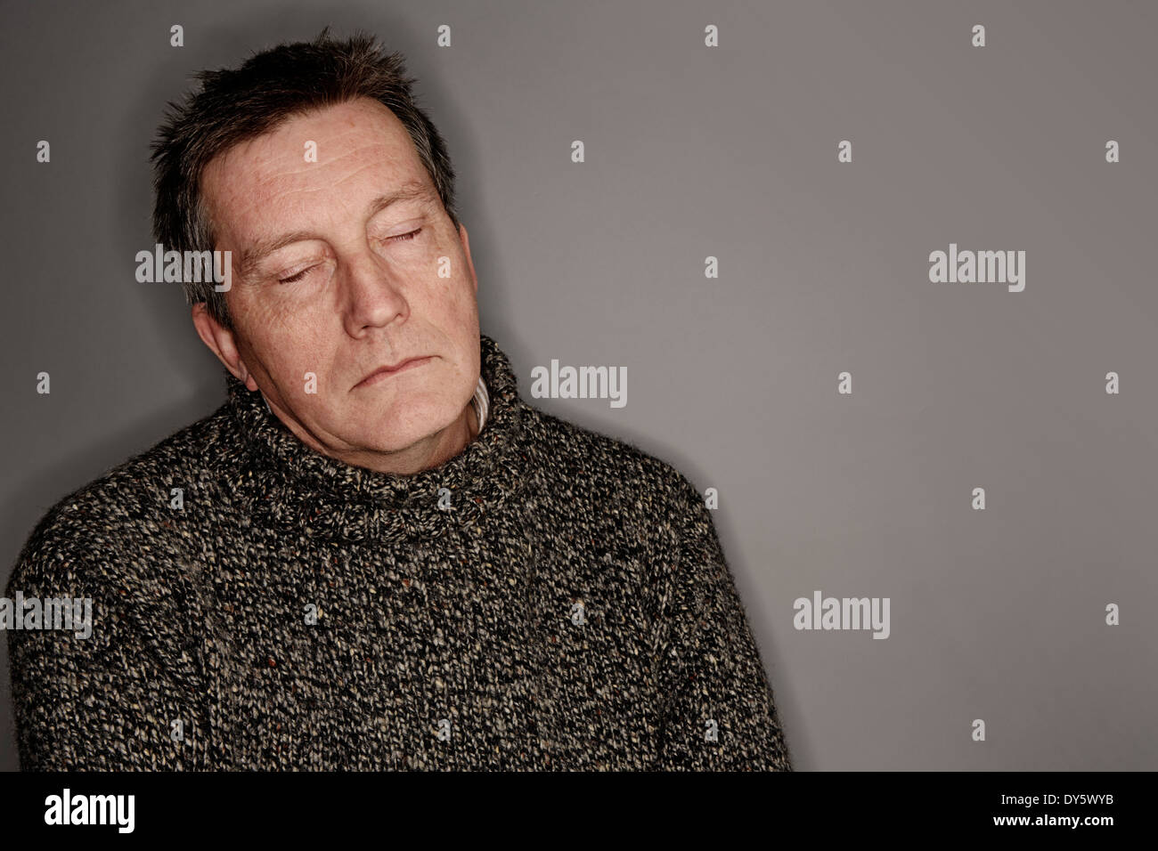 older man with eyes shut, asleep - Stock Image