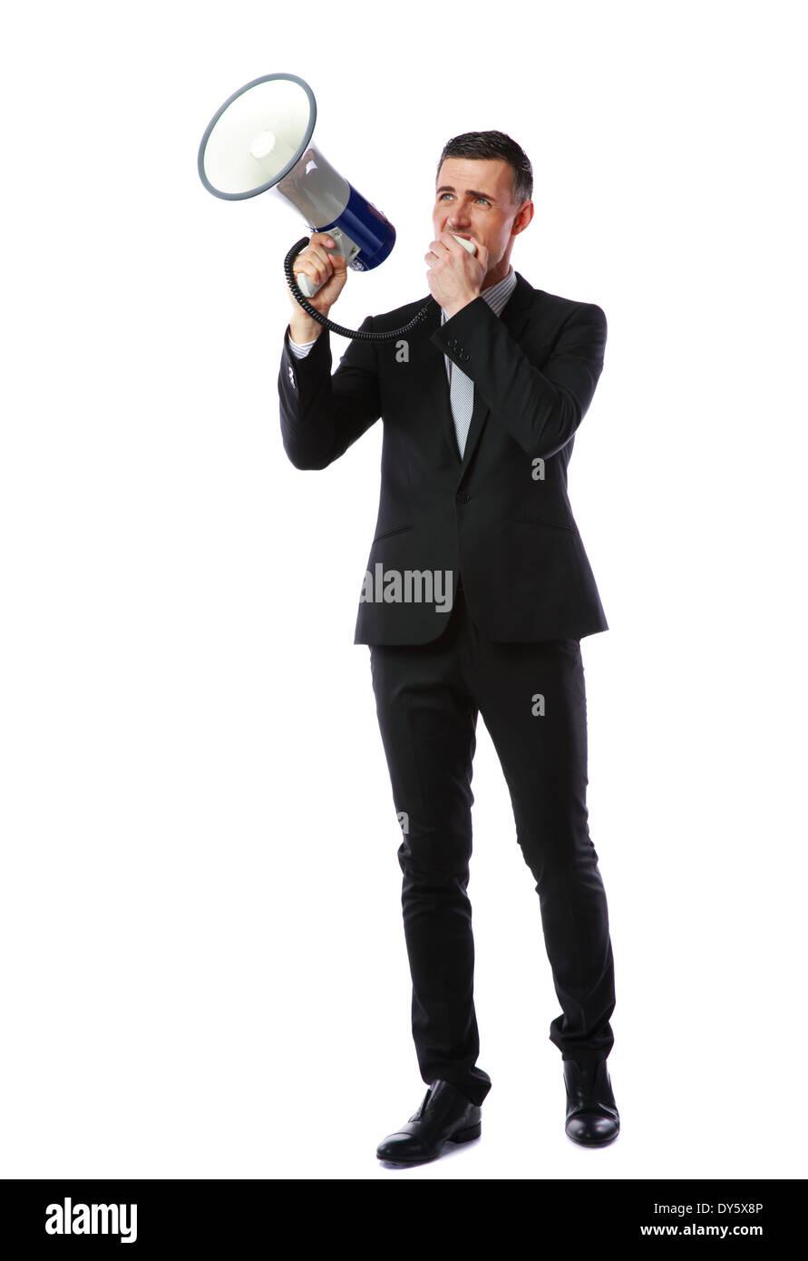 Full length portrait of businessman shout through megaphone isolated on white background - Stock Image