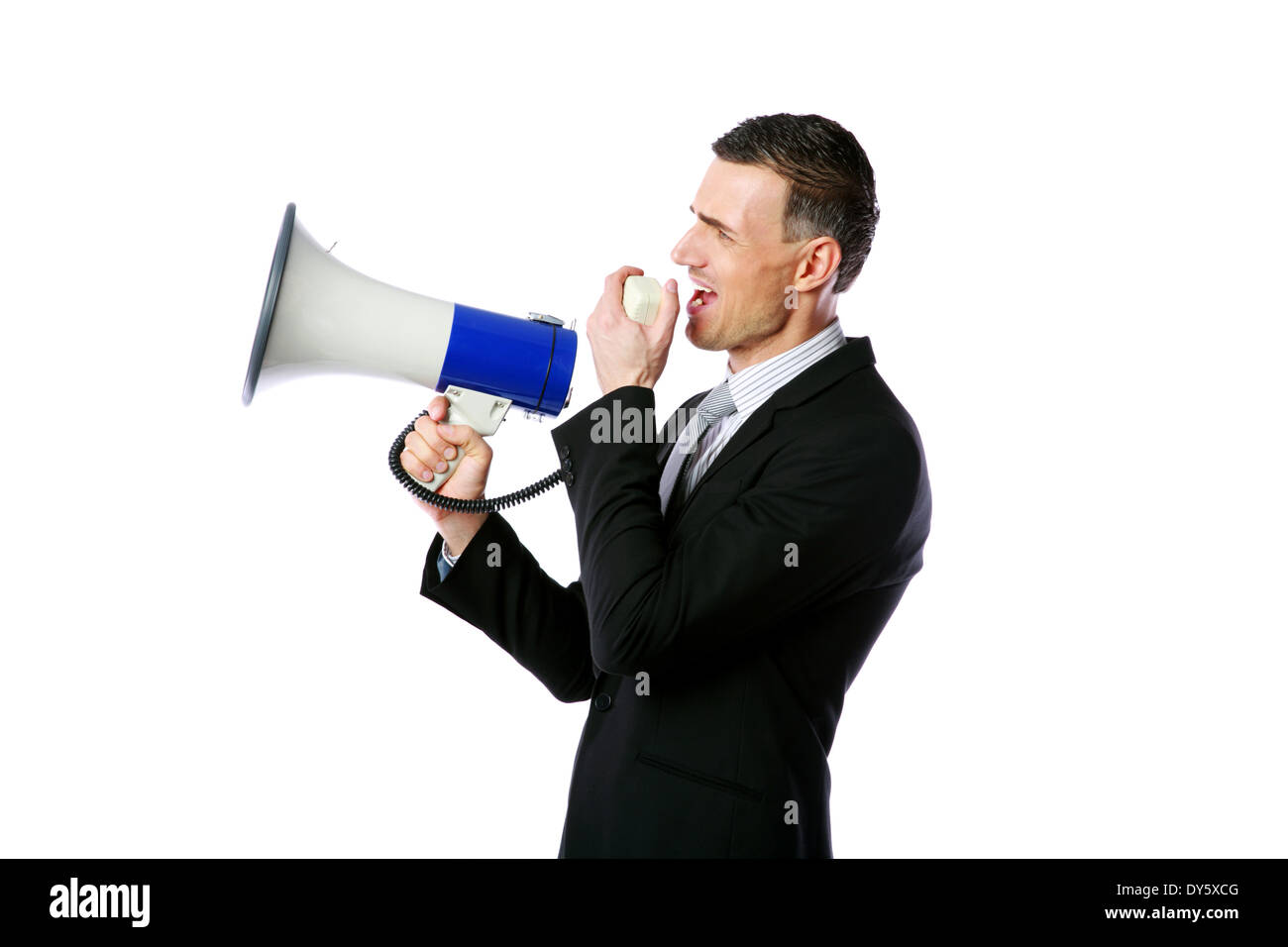 Portrait of businessman shouting through megaphone isolated on white background - Stock Image