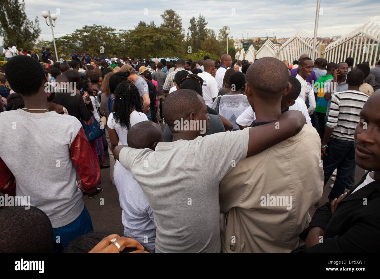 Kigali, Rwanda. 7th April 2014. Rwandans take part in 'Kwibuka Twiyubaka' Walk to Remember. The walk started at the Rwandan Parliament and ended at Amahoro stadium. This year marks the 20th anniversary of the genocide against the Tutsis. During the approximate 100-day period from April 7, 1994 to mid-July, an estimated 500,000–1,000,000 Rwandans were killed, constituting as much as 20% of the country's total population and 70% of the Tutsi then living in Rwanda. Credit:  Tom Gilks/Alamy Live News - Stock Image