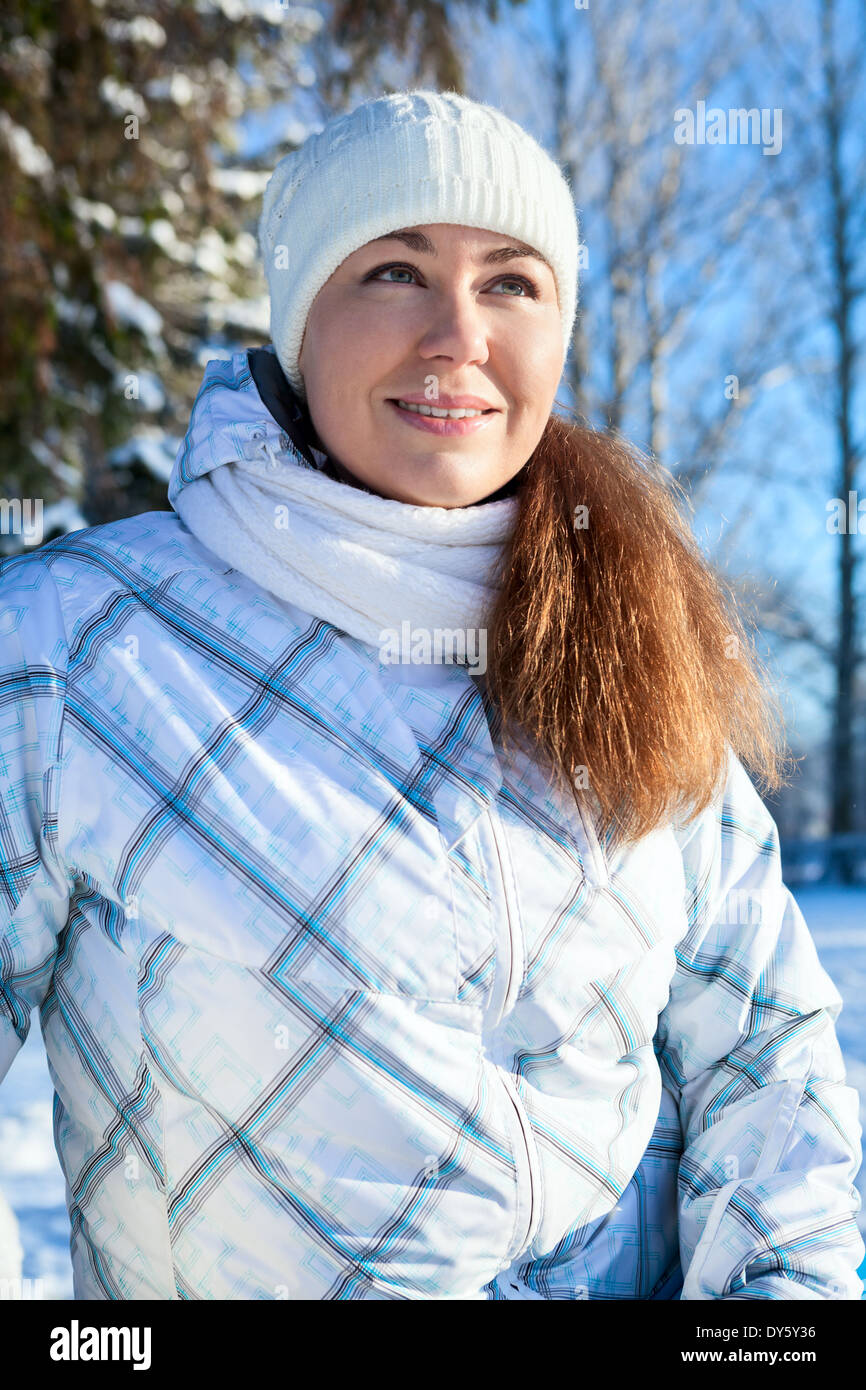 Caucasian woman in winter clothes at sunny day - Stock Image
