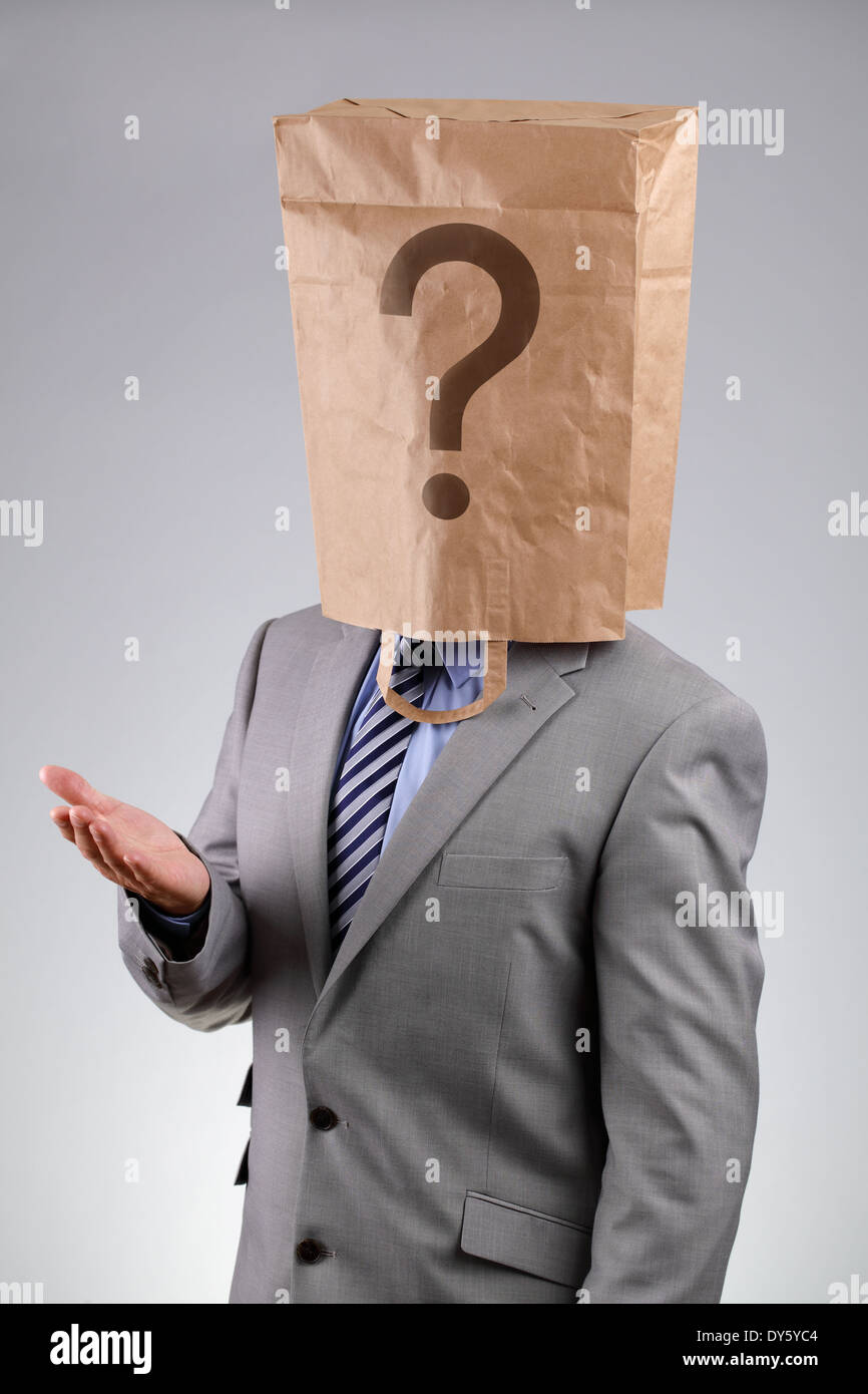 Anonymous businessman with paper bag on his head - Stock Image
