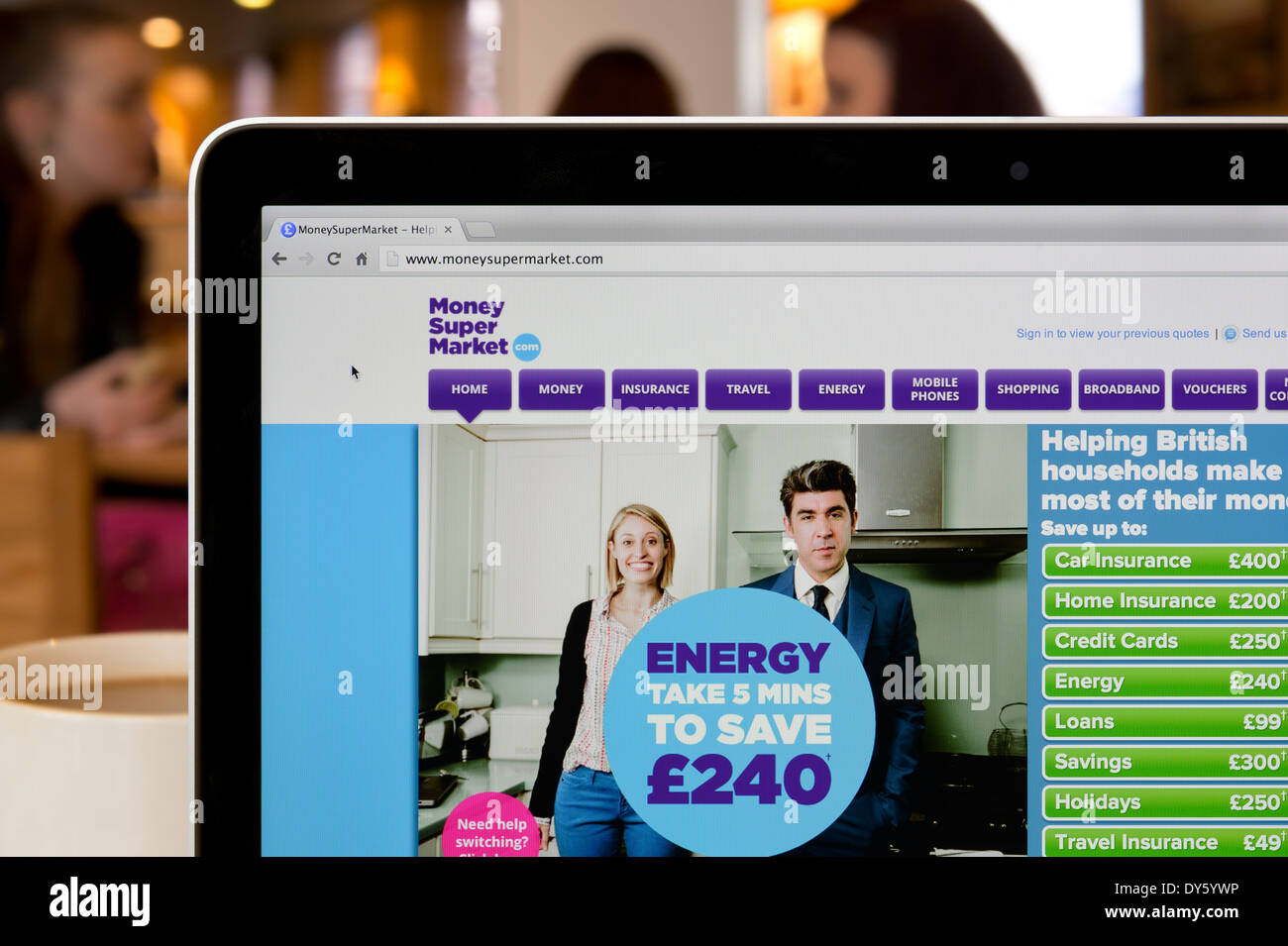 The Money Saving Expert website shot in a coffee shop environment (Editorial use only: print, TV, e-book & - Stock Image