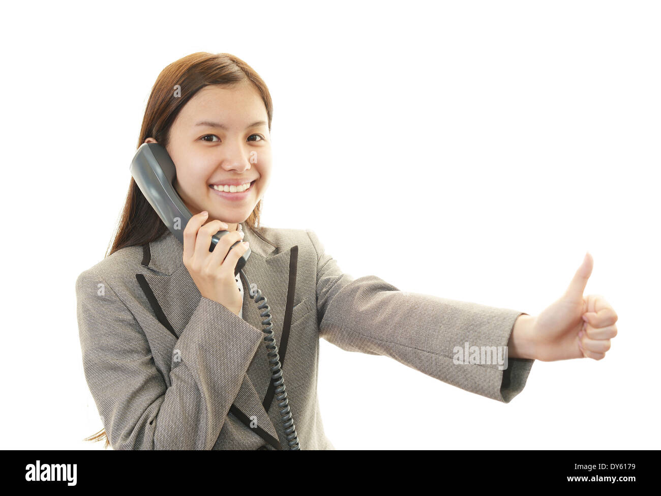 Handset with woman. - Stock Image