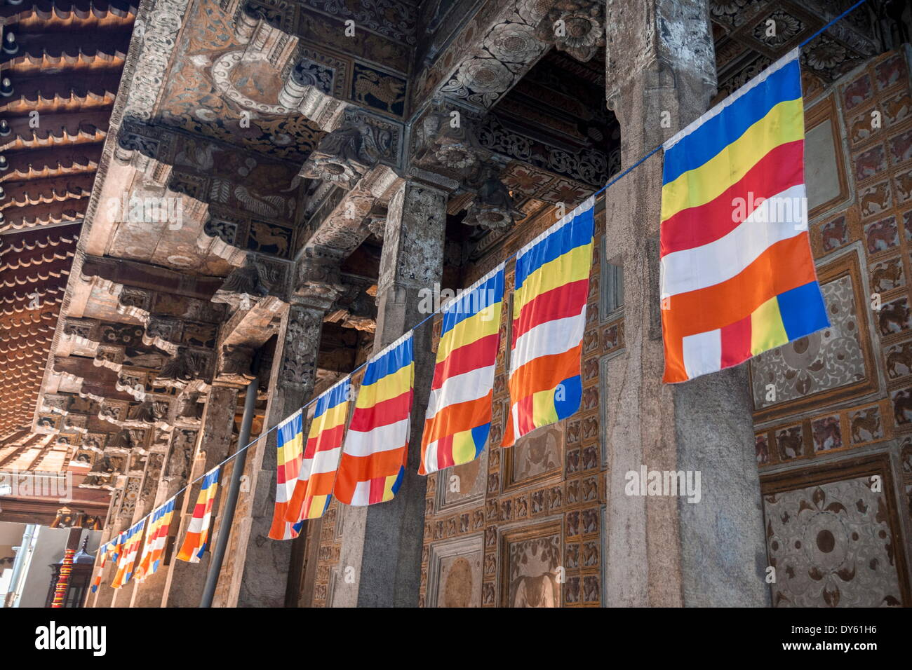 Colourful Buddhist flags adorning columns, Temple of the Sacred Tooth Relic, UNESCO World Heritage Site, Kandy, Sri Lanka, Asia - Stock Image