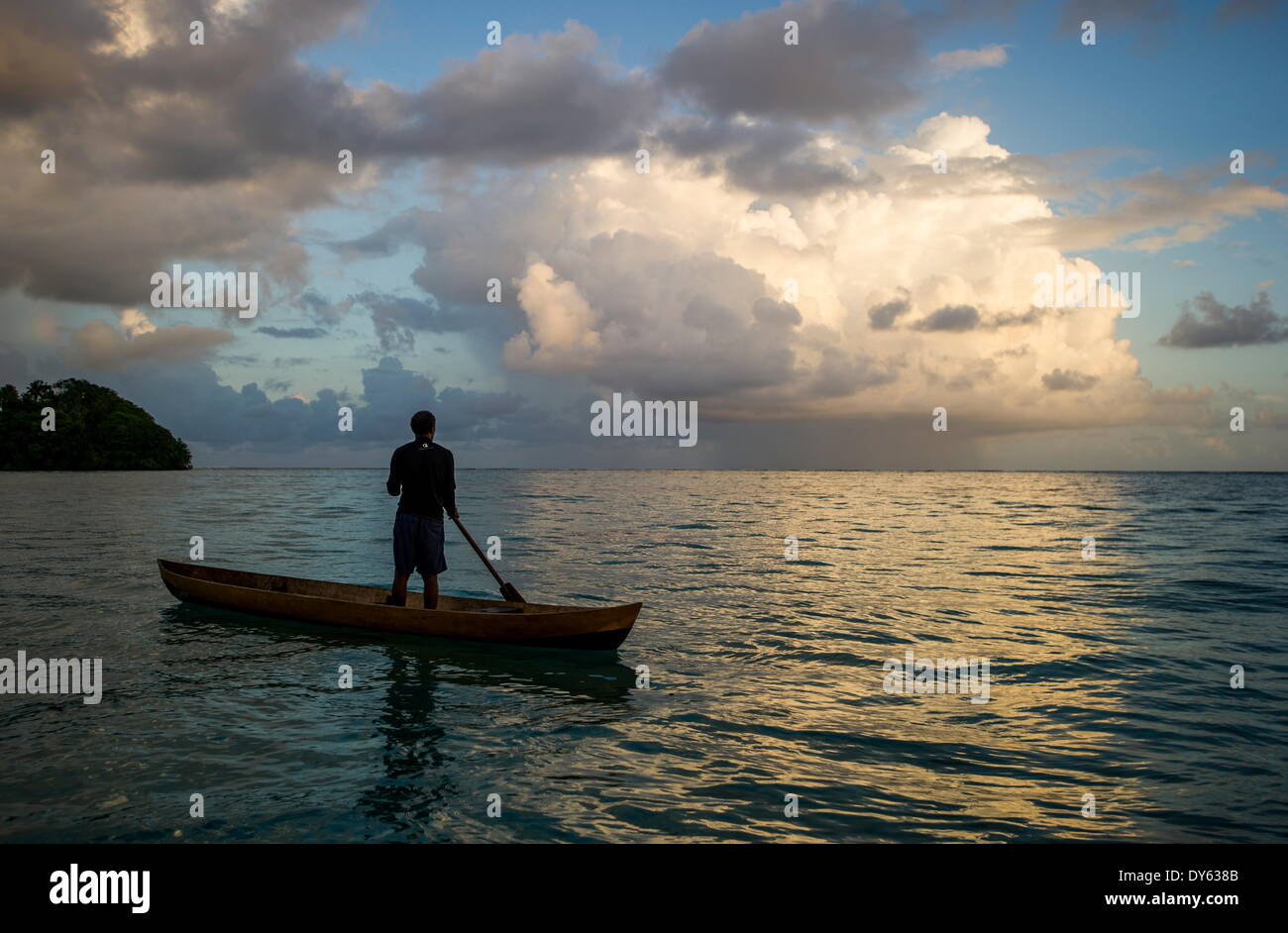 A man in a dug out canoe, Solomon Islands, Pacific - Stock Image