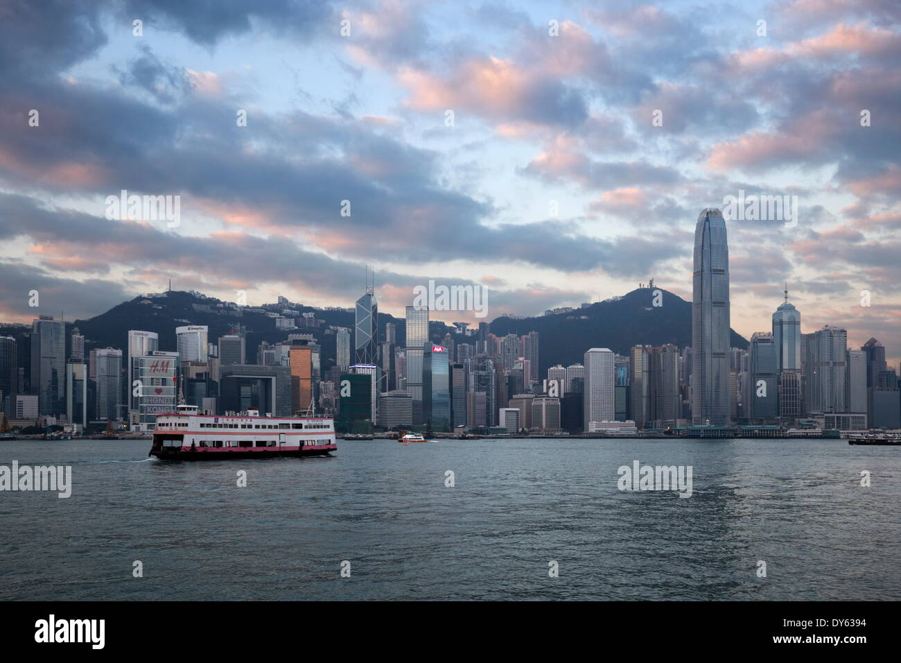 View over Victoria harbour to Hong Kong Island and The Peak at dusk, Hong Kong, China, Asia - Stock Image