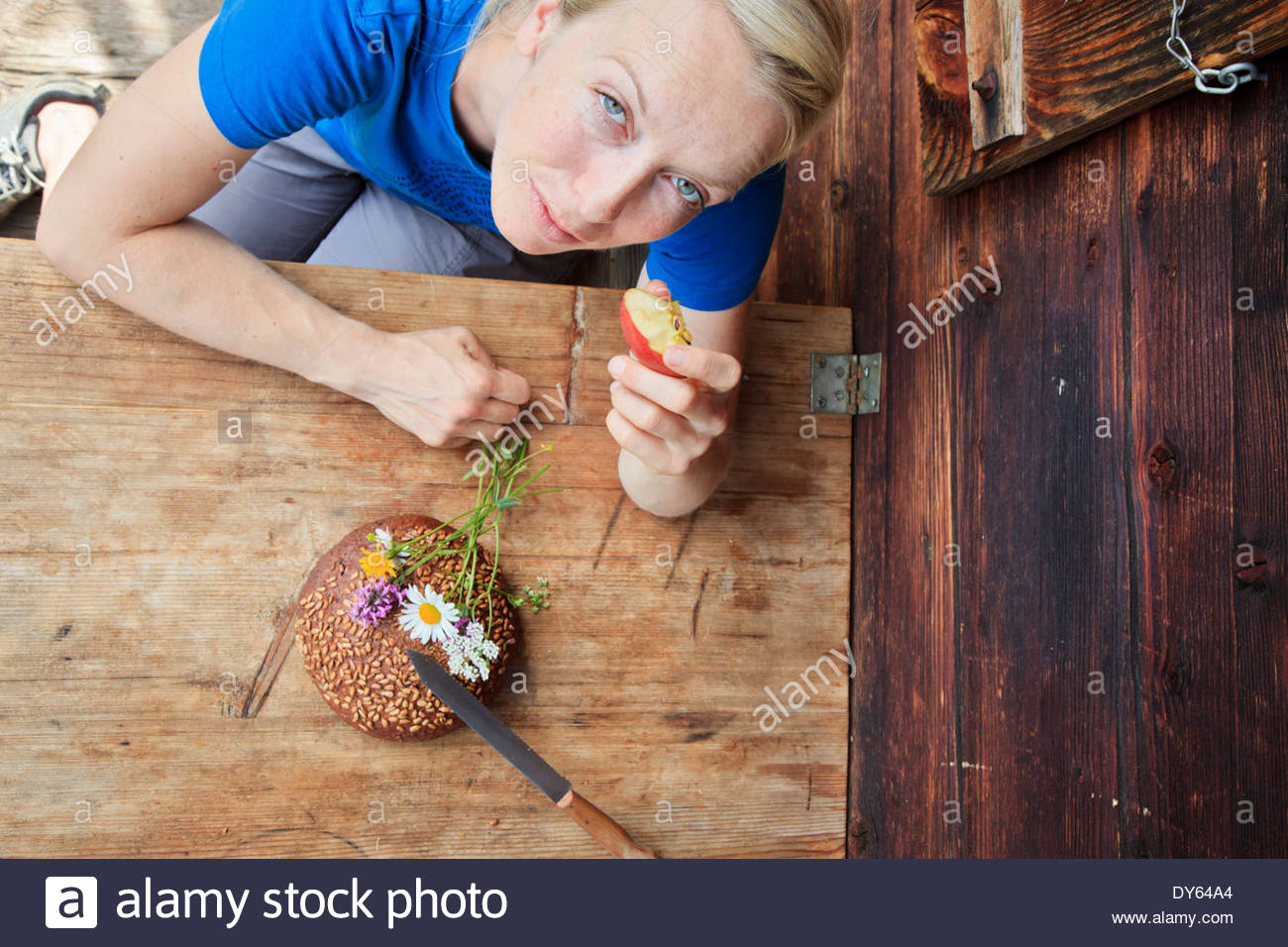 Woman enjoying a snack on a farm, Kloaschau Valley, Bayrischzell, Bavaria, Germany - Stock Image