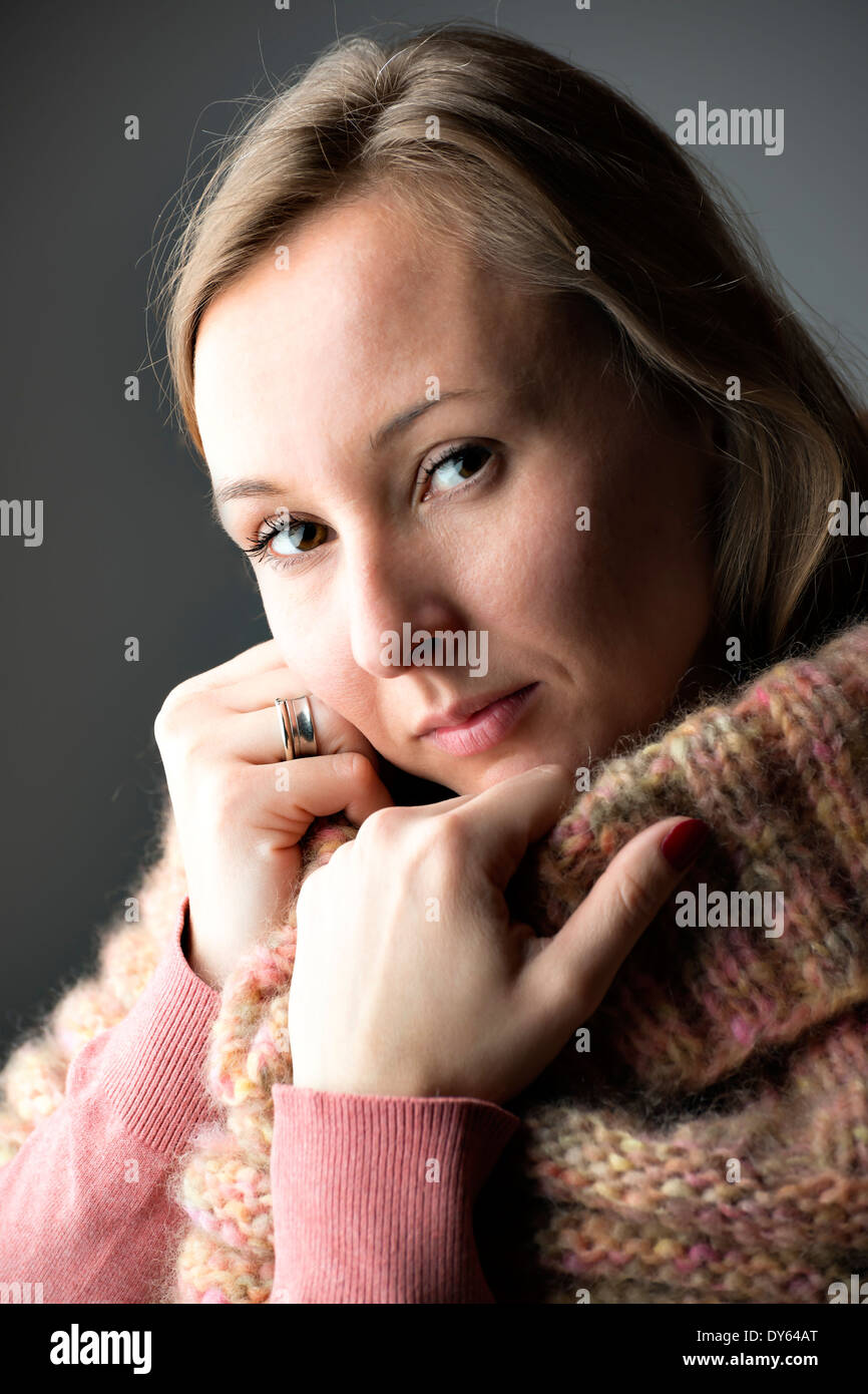Portrait of a young woman with wool scarf - Stock Image
