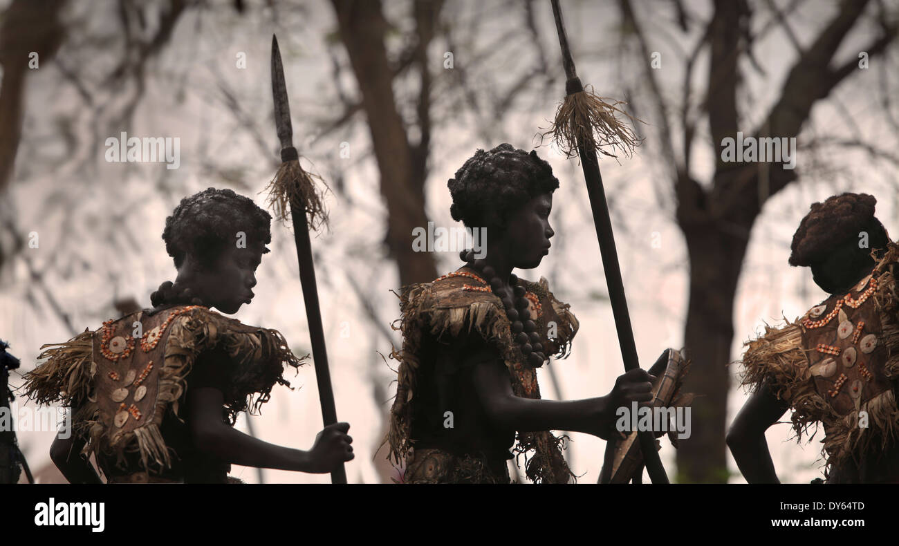 Silhouetts of three children with black smeared faces, Ati Atihan Festival, Kalibo, Aklan, Western Visayas Region, - Stock Image