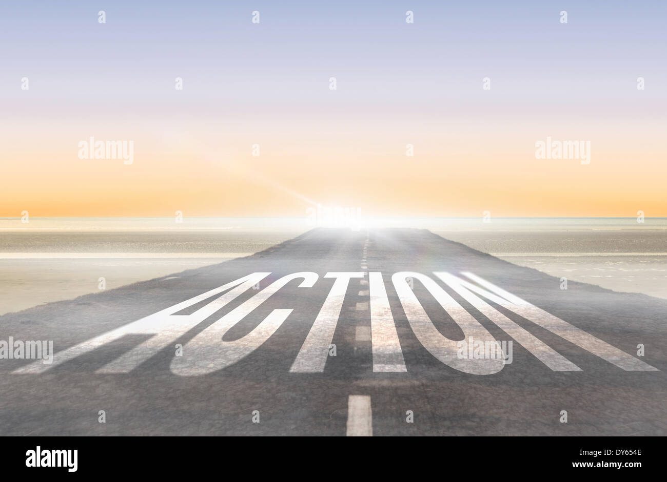 Action against road leading out to the horizon - Stock Image