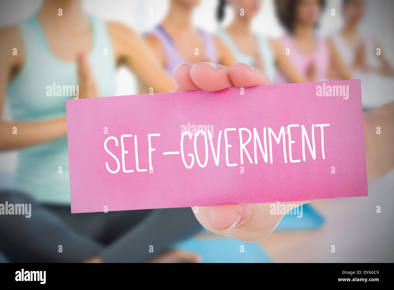 Woman holding pink card saying self government - Stock Image
