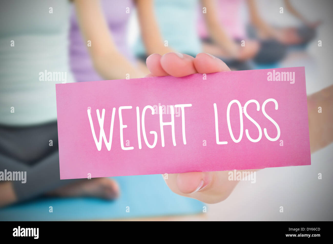 Woman holding pink card saying weight loss - Stock Image