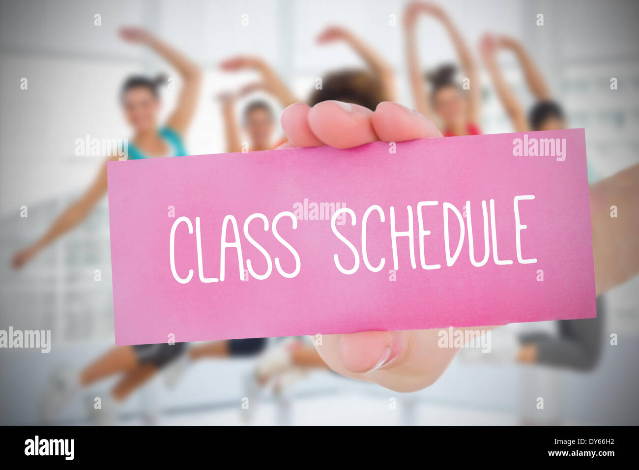 Woman holding pink card saying class schedule - Stock Image