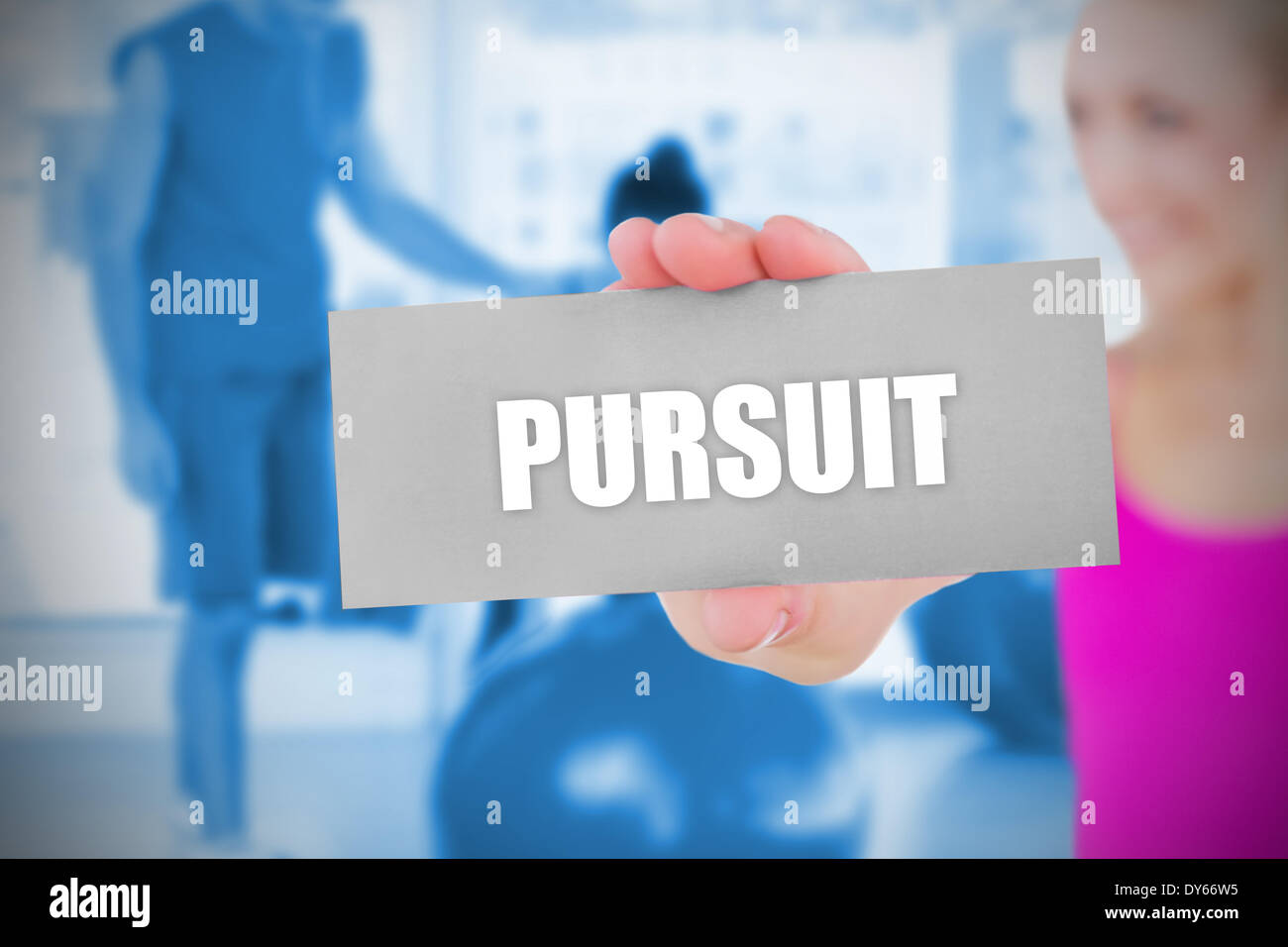 Fit blonde holding card saying pursuit - Stock Image